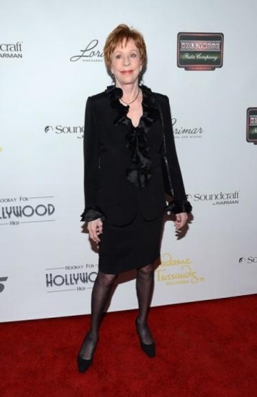 Carol Burnett wears a black ruffle jacket