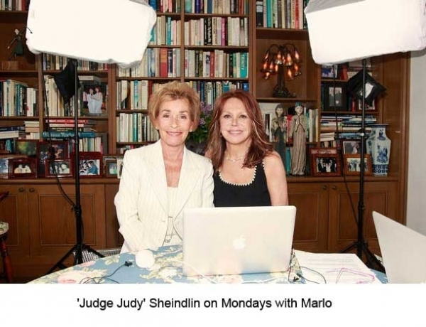 Judge Judy wearing a white pantsuit designed by Susanna Beverly Hills