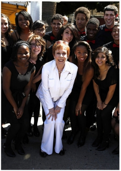 Carol Burnett wear a white pantsuit designed by Susanna Beverly Hills