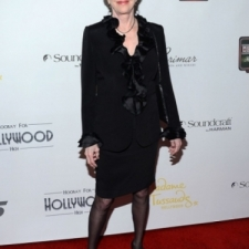 Carol Burnett wears a black ruffle jacket
