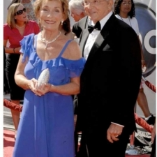 Beautiful purple evening gown worn by Judge Judy Sheindlin at the Academy Awards