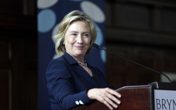 Hillary Clinton wearing a custom navy pantsuit