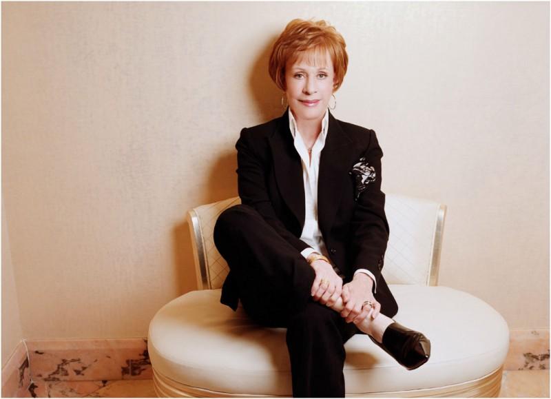 Carol Burnett wearing elegant black pantsuit designed by Susanna Beverly Hills