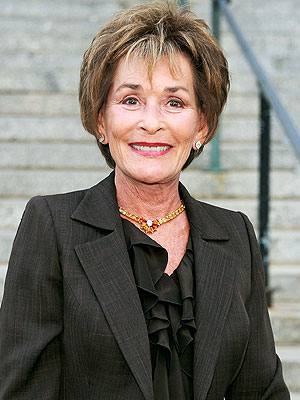 Judge Judy wearing a beautiful brown pantsuit suit by Susanna Beverly Hills