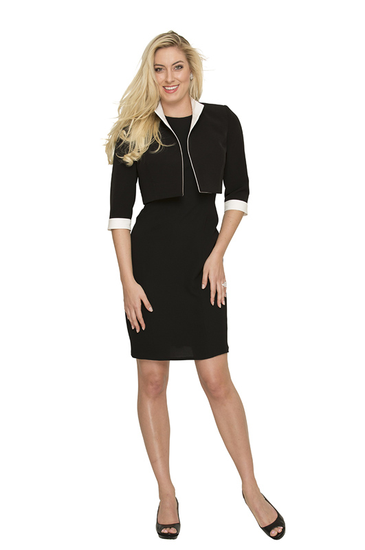 black-bolero-jacket-with-white-trim-worn-over-a-black-shift-dress